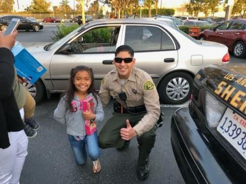 Little girl posing with officer